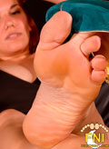Dominant Elena De Luca from NYC invites you to worship her gorgeous high-arched size 7 feet!